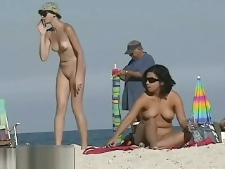 Stunning tanned babes are surrounding become absent-minded nudist coast