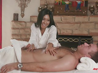 Asian MILF babe Honey Moon massages a bushwa with their way shaved pussy