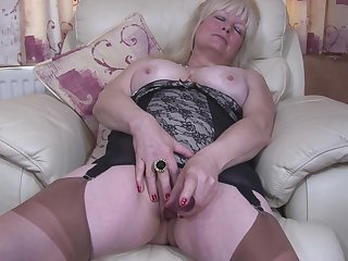 Buxom crude mature British granny Cindy S. masturbates in pantyhose