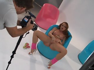 Sultry redhead Silvia Saint masturbates for a photographer