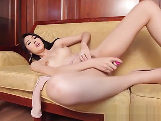 Hot ladyboy spreading wide and dildoing her pussy