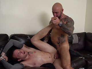 Muscular man ass fucks gay slave and forces him to swallow