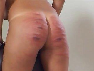 Slut enjoys having her ass spanked hard by a dominant blonde