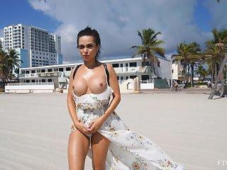 Gorgeous hottie Crystal loves flashing the brush round fake tits