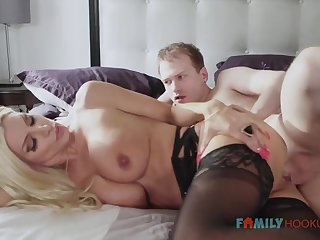 Sizzling blnde COUGAR is wearing softcore, dark-hued stocking while having fuck-a-thon with her spouse's helpmate