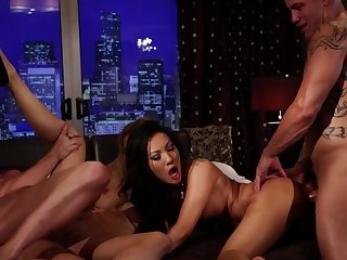 Two sexy girls are having fun surrounding two eager men in the video